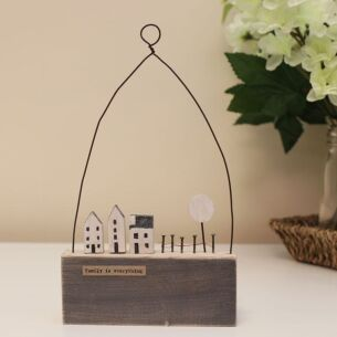 'Family Is Everything' Houses and Fence Wooden Scene