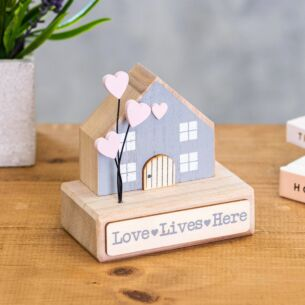 'Love Lives Here' Wooden House